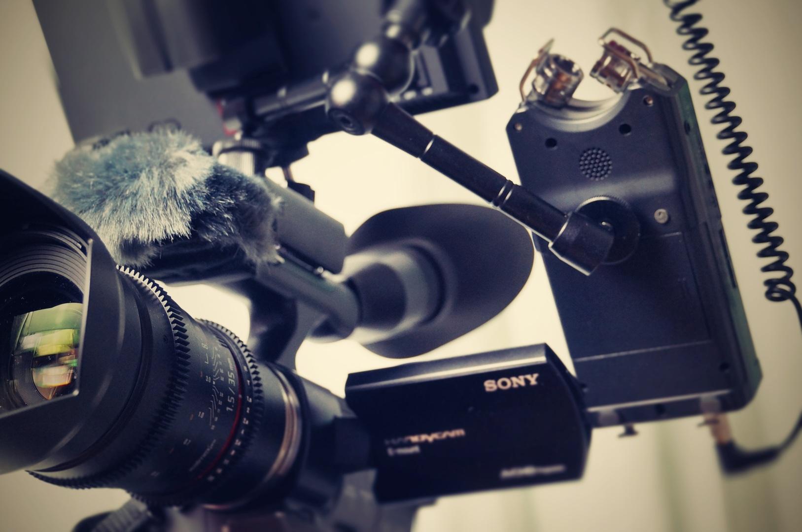 XDCAM camera with lens.