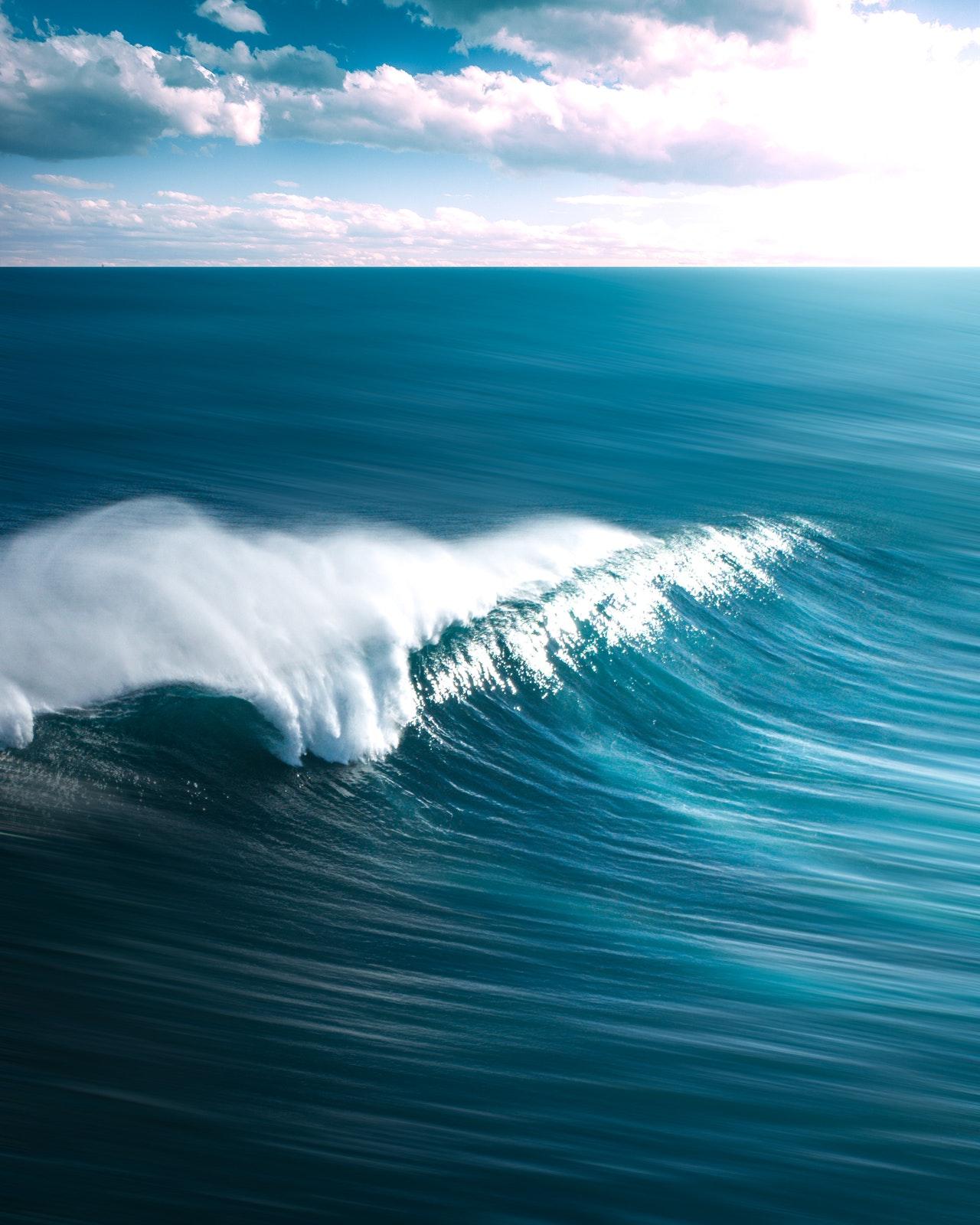 Blue ocean waves flowing gently
